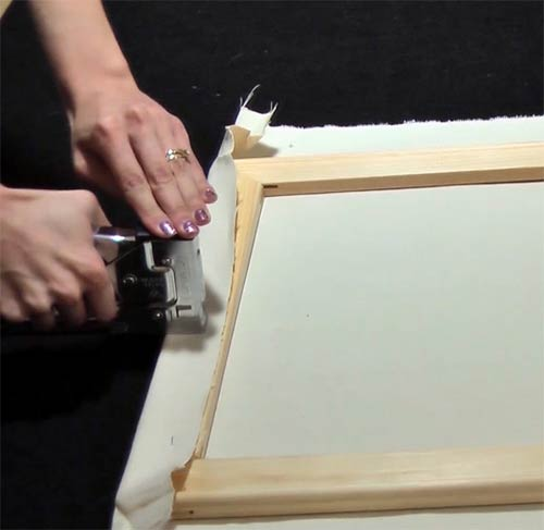 Make your own canvas - stapling the canvas